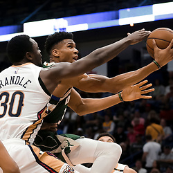 Mar 12, 2019; New Orleans, LA, USA; Milwaukee Bucks forward Giannis Antetokounmpo (34) is defended by New Orleans Pelicans center Julius Randle (30) during the second half at the Smoothie King Center. Mandatory Credit: Derick E. Hingle-USA TODAY Sports