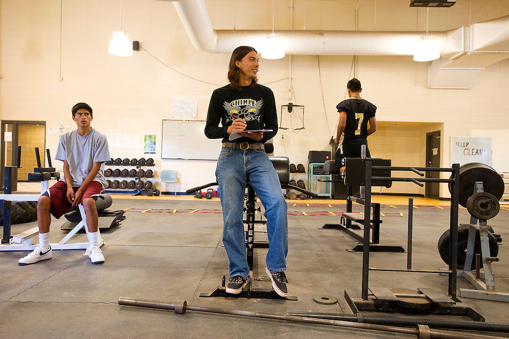 101311       Brian Leddy.Chinle High School Strength and Conditioning teacher Shaun Martin tests students on their weightlifting technique Thursday at the school. Martin was recently named Arizona Rural Teacher of the Year.