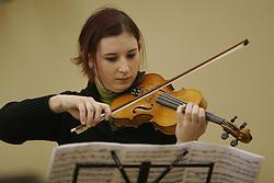 Girl playing a violin. (Photo by Vid Ponikvar / Sportida)