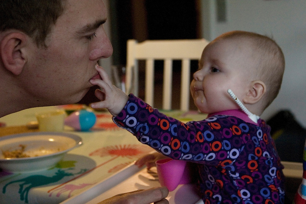 Aarhus, Denmark, June 10th 2010. Thomas  feeding Laura. Thomas is at home studying engineering and helping his wife Gitte to take care of the little Laura, 8 months old. Gitte, a social educator, took 1 year of maternity leave.