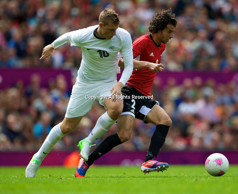 29.07.2012 Manchester, England. Egypt defender Mahmoud Alaa El-Din and New Zealand forward Chris Wood in action during the first round group C mens match between Egypt and New Zealand.