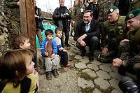 05 DEC 2005, SERBIA/KOSOVO/PRIZREN:<br /> Dr. Franz-Josef Jung (M), CDU, Bundesverteidigungsminister, im Gespraech mit kleinen Kindern am Wegesrand, (2.v.R: Oberstleutnant Karsten Jahn, Kommandeur Task Force Prizren) waehrend einem Gang durch die Stadt, im Rahmen eines Besuches des Deutschen Einsatzkontingents KFOR (Kosovo Force)<br /> IMAGE: 20051205-01-048<br /> KEYWORDS: Gespräch, Bundeswehr