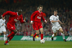 CARDIFF, WALES - Sunday, March 2, 2003: Liverpool's Dietmar Hamann is chased by Manchester United's Roy Keane during the Football League Cup Final at the Millennium Stadium. (Pic by David Rawcliffe/Propaganda)