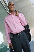 Businessman holding coat over shoulder, portrait