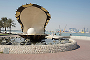 The Pearl Monument in front of the skyline of Western Corniche.