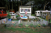 Camping trailer with American flags and garden