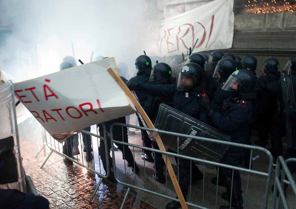 Police and protesters tonight clashed violently outside La Scala. At least 10 police officers and an unknown number of demonstrators were taken to hospital after the skirmishes in which two home-made bombs were detonated. Smoke bombs and teargas were used during the clash...Marco Secchi/XianPix.email msecchi@gmail.com