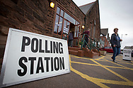 Voters leaving a polling station in West Kirby, Wirral after casting their votes at the 2015 UK General Election. They were voting in the marginal Wirral West constituency, held since the 2010 election by Esther McVey MP for the Conservative Party. Voters went to the polls across the UK on 7th May to elect 659 member of parliament.