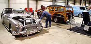 Ronald and Susan Lewis of Joplin, Missouri look at Kelly Smith of Arcanum's 1949 Buick boattail during the KOI Hot Rod Fest Dayton at the Dayton Airport Expo Center in Vandalia, Sunday, March 12, 2012.  They are in the area while Ronald does pipefitting work.
