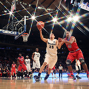 Tyler Harris, (left), Providence, chases a rebound while challenged by Orlando Sanchez, St. John's during the Providence Vs St. John's Red Storm basketball game during the Big East Conference Tournament at Madison Square Garden, New York, USA. 12th March 2014. Photo Tim Clayton
