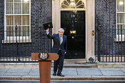 © Licensed to London News Pictures. 13/12/2019. London, UK. British Prime Minister and leader of the Conservative Party, BORIS JOHNSON, waves to the media after making a statement in 10 Downing Street after asking Queen Elizabeth II to form a Government, as the Conservative Party wins a majority in the General Election 2019. Photo credit: Dinendra Haria/LNP