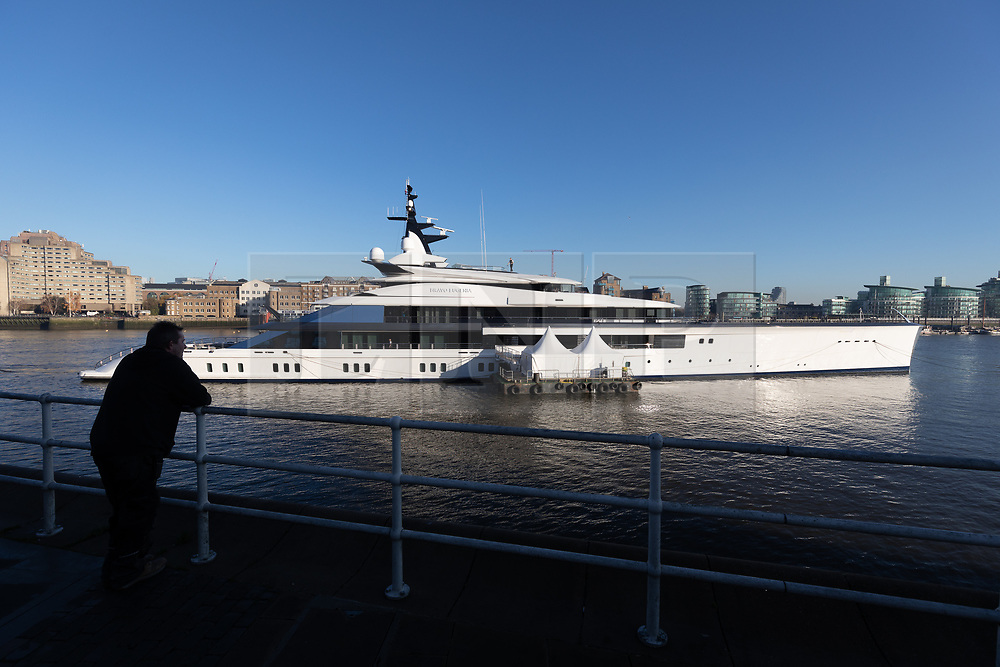 © Licensed to London News Pictures. 04/12/2019. London, UK. A man looks at Dallas Cowboys owner and billionnaire, Jerry Jones's luxury 358 feet (109 meters) superyacht, Bravo Eugenia which is seen moored at Butlers Wharf, near Tower Bridge on the River Thames after arriving in the capital late yesterday afternoon. The $225 million yacht which was built in 2018 is reported to be named after Jerry Jones's wife, Eugenia and have multiple luxuries onboard including two helipads, a fitness centre and sauna, and is capable of sleeping up to 14 people who are taken care of by a 30-person crew. Photo credit: Vickie Flores/LNP