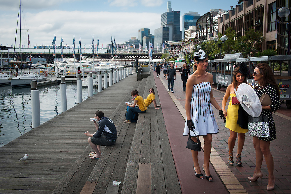 Australia, Sydney. Darling Harbour. People dressed up to watch the Melbourne Cup races in bars and restaurants.
