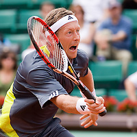 04 June 2007: Jonas Bjorkman of Sweden hits a forehand shot  to Carlos Moya of Spain during the French Tennis Open fourth round match won 7-6(5), 6-2, 7-5 by Carlos Moya over Jonas Bjorkman on day 9 at Roland Garros, in Paris, France.