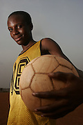 12 year old Salahu Mohammed. He has been with Corners Babies for 2 years and been training seriously for 3 years.  A Real Madrid fan whose favourite player is Robinho. Football practice and training for the under 12's team of Corners Babies youth football Academy. Two of the academy's past players now play for the national team, the Black Stars.  Kumasi- Ghana's second largest city. West Africa..©Picture Zute Lightfoot.  07939 108077. www.lightfootphoto.co.uk