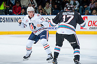 KELOWNA, CANADA - SEPTEMBER 25: Rodney Southam #17 of Kelowna Rockets drops the gloves with Luke Harrison #17 of Kamloops Blazers on September 25, 2015 at Prospera Place in Kelowna, British Columbia, Canada.  (Photo by Marissa Baecker/Shoot the Breeze)  *** Local Caption *** Rodney Southam; Luke Harrison;