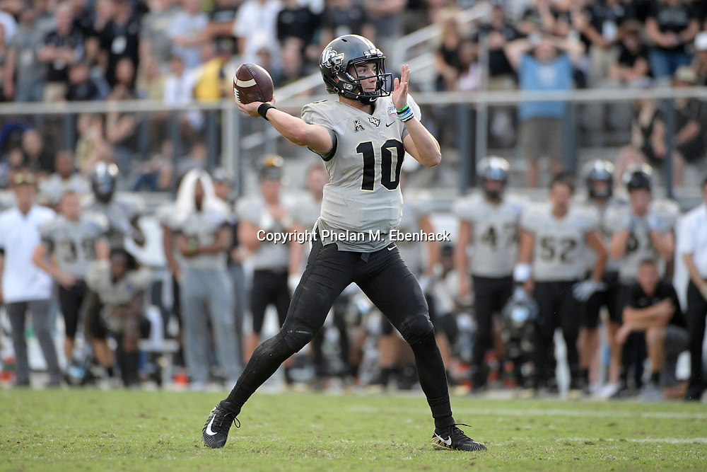 Central Florida quarterback McKenzie Milton (10) throws a pass during the second half of the American Athletic Conference championship NCAA college football game against Memphis Saturday, Dec. 2, 2017, in Orlando, Fla. Central Florida won 62-55. (Photo by Phelan M. Ebenhack)