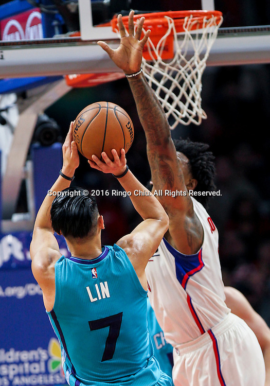 Charlotte Hornets Jeremy Lin shoots against Los Angeles Clippers DeAndre Jordan during the NBA basketball game against Charlotte Hornets in Los Angeles, the United States, Jan. 9, 2016. Los Angeles Clippers won 97-83. (Xinhua/Zhao Hanrong)(Photo by Ringo Chiu/PHOTOFORMULA.com)<br /> <br /> Usage Notes: This content is intended for editorial use only. For other uses, additional clearances may be required.
