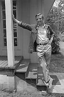 1976, Georgia, USA --- Democratic vice presidential candidate Walter Mondale, running mate of presidential candidate Jimmy Carter, stands on porch steps of a house during the 1976 presidential election season. --- Image by © Owen Franken/Corbis