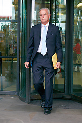© Licensed to London News Pictures.  10/09/2012. LONDON, UK. Tim O'Toole, CEO of First Group (pictured) leaves the Houses of Parliament after giving evidence to the Transport Select Committee. Rival Virgin Trains, headed by Sir Richard Branson (not pictured), lost the West Coast Mainline franchise to First Group. Photo credit :  Cliff Hide/LNP