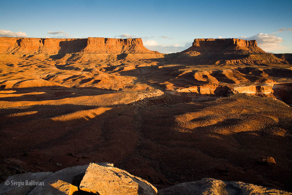 Views of the Needles and Maze districts at sunset as seen from the Murphy Hogback campsite on the White Rim Trail in Canyonlands National Park, Utah.