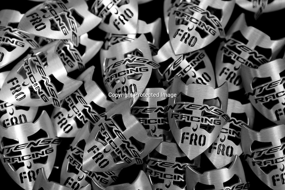 These headbadges for the Intense Cycles 951 downhill mountain bike are waiting on the assembly line at the factory in Temecula, California.