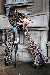 © under license to London News Pictures.  13/03/11 A man dressed as a giraffe takes a break from the parade during St Patrick's Day celebrations in central London. Photo credit should read: Olivia Harris/ London News Pictures