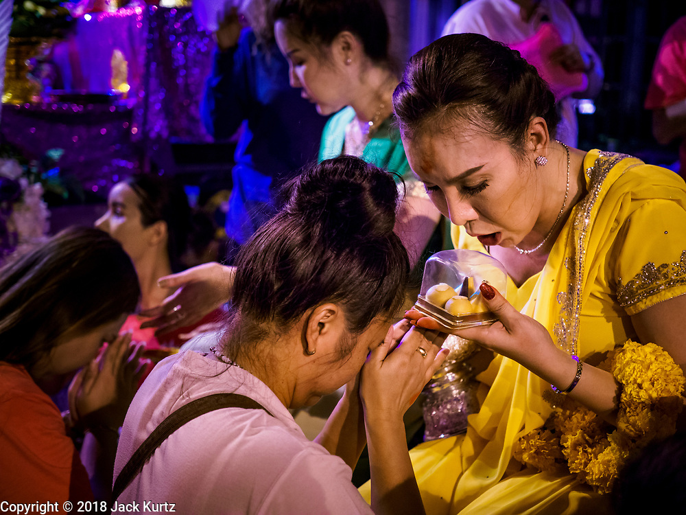 19 OCTOBER 2018 - BANGKOK, THAILAND: A blessing ceremony for women and transgendered people during Navratri observances in Bangkok. Navratri is a nine night (10 day) long Hindu celebration that marks the end of the monsoon and honors of the divine feminine Devi (Durga). The festival is celebrated differently in different parts of India, but the common theme is the battle and victory of Good over Evil based on a regionally famous epic or legend such as the Ramayana or the Devi Mahatmya. Navratri is celebrated throughout Southeast Asia in communities that have a large Hindu population. Because Navratri honors the feminine Devi, Navratri is especially popular with Thai women and transgendered people.  PHOTO BY JACK KURTZ