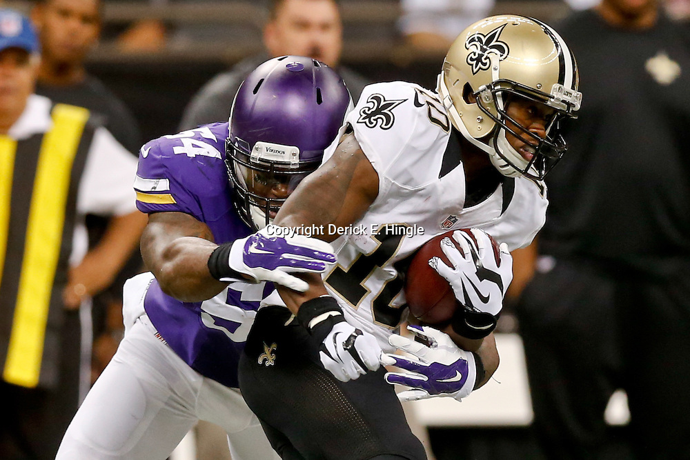 Sep 21, 2014; New Orleans, LA, USA; Minnesota Vikings middle linebacker Jasper Brinkley (54) tackles New Orleans Saints wide receiver Brandin Cooks (10) during the second quarter of a game at Mercedes-Benz Superdome. Mandatory Credit: Derick E. Hingle-USA TODAY Sports