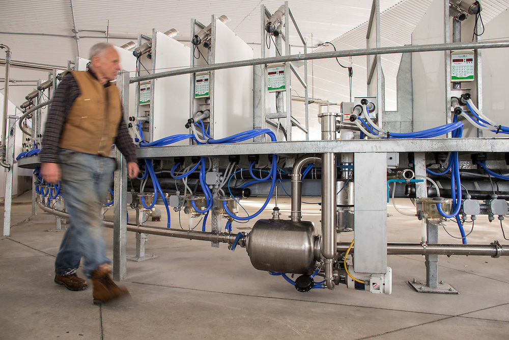 Dairy goat farmer Leo Donkers, walks past his new rotary milking parlour on the family farm near Shedden, Ontario, Monday,  February 2, 2015.<br /> Farmers Forum/ Geoff Robins