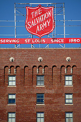 20 October 2010:  a well kept old neon sign stands on top of a building at the west end of downtown St. Louis and announces the Salvation Army, serving St. Louis since 1880.  St. Louis Missouri