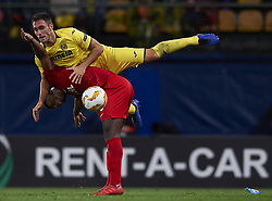 December 13, 2018 - Villarreal, Castellon, Spain - Victor Ruiz of Villarreal and Ze Luis of Spartak Moskva battle for the ball during the Group G match of the UEFA Europa League between Villarreal CF and Spartak Moskva at La Ceramica Stadium Villarreal, Spain on December 13, 2018. (Credit Image: © Jose Breton/NurPhoto via ZUMA Press)