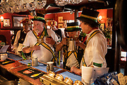 Thaxted Morris Weekend 3-4 June 2017<br />A meeting of member clubs of the Morris Ring celebrating the 90th anniversary of the founding of the Thaxted Morris Dancing side or team in Thaxted, North West Essex, England UK. <br />First orders at 10am for a breakfast beer at The Crown , Liitle Walden Essex.<br />Hundred of Morris dancers from the UK and this year the Silkeborg side from Denmark spend most of Saturday dance outside pubs in nearby villages where much beer is consumed. In the late afternoon all the sides congregate in Thaxted where massed dancing is perfomed along Town Street. As darkness falls across Thaxted the spell binding Abbots Bromley Horn Dance is performed to the sound of a solo violin in the dark.
