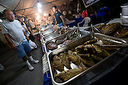 Stalls sell a variety of fare at the weekly night market in Garapan, Saipan.  .Robert Gilhooly Photo