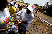 A community volunteer marks the finger of a child with ink aboard a ferry at the ferry terminal in Makango, northern Ghana, to find children to vaccinate during a national polio immunization exercise on Thursday March 26, 2009.