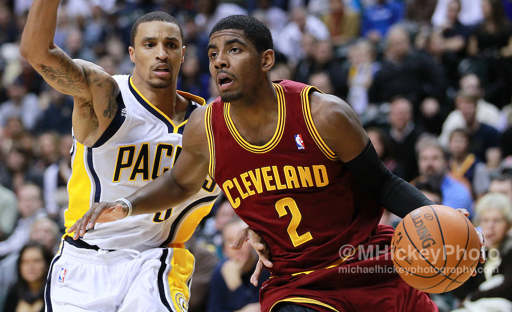 Dec. 30, 2011; Indianapolis, IN, USA; Cleveland Cavaliers guard Kyrie Irving (2) dribbles around Indiana Pacers point guard George Hill (3) at Bankers Life Fieldshouse. Indiana defeated Cleveland 81-91. Mandatory credit: Michael Hickey-US PRESSWIRE