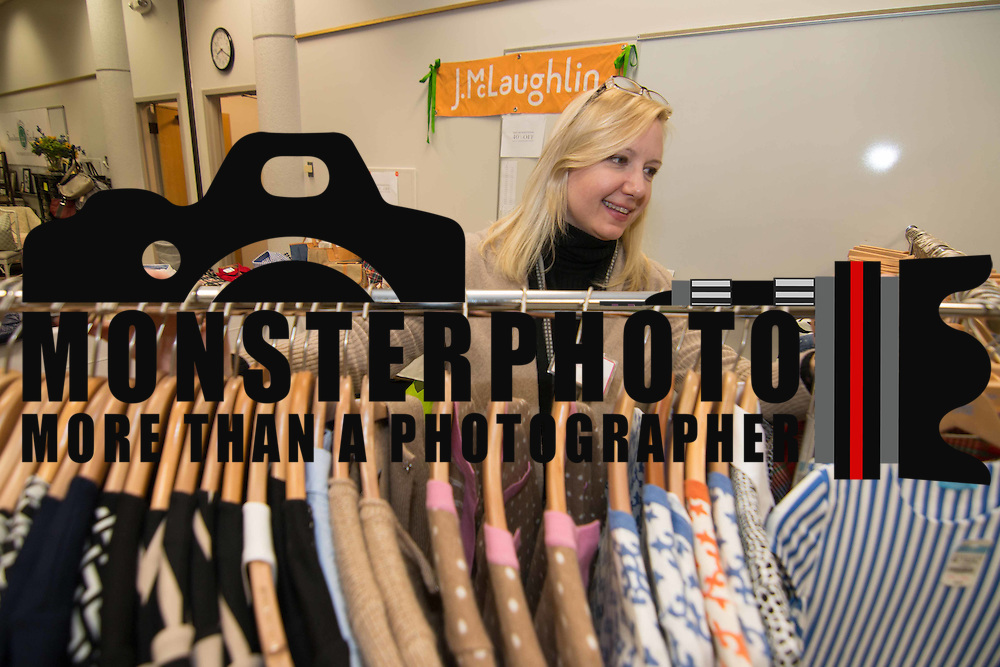 Liese Kolb seen near a rack of fashions at the J. McLaughlin booth during the 3rd Annual Guilty Girls Warehouse Sale Friday, Feb. 06, 2015 at University of Delaware's Arsht Hall in Wilmington, DE.