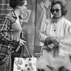 Shoppers mingling on High Street in Worthington for the opening day of the farmer's market Saturday May 3, 2014. (Christina Paolucci, photographer).