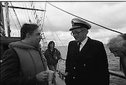 Round Europe Yacht Race.   (R61)..1987..25.07.1987..07.25.1987..25th July 1987..President Patrick Hillery started the Round Europe Yacht Race which began at Dun Laoghaire today...Photograph shows Commissioner Peter Sutherland in conversation with Commodore Liam Brett,Flag Officer, Commanding the Naval Service.