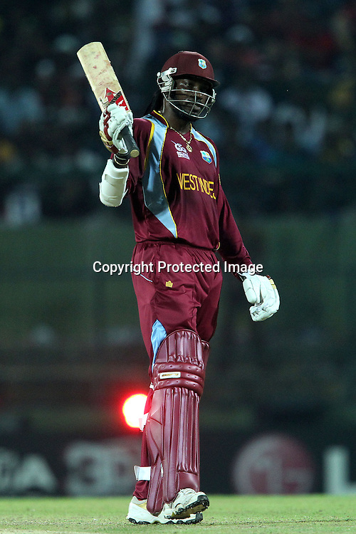 Chris Gayle of The West Indies celebrates his fifty during the ICC World Twenty20 Super 8s match between England and The West Indies held at the  Pallekele Stadium in Kandy, Sri Lanka on the 27th September 2012<br /> <br /> Photo by Ron Gaunt/SPORTZPICS