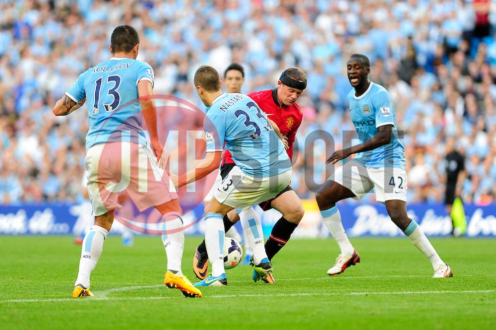 Manchester United's Wayne Rooney runs into Manchester City's Matija Nastasic - Photo mandatory by-line: Dougie Allward/JMP - Tel: Mobile: 07966 386802 22/09/2013 - SPORT - FOOTBALL - City of Manchester Stadium - Manchester - Manchester City V Manchester United - Barclays Premier League