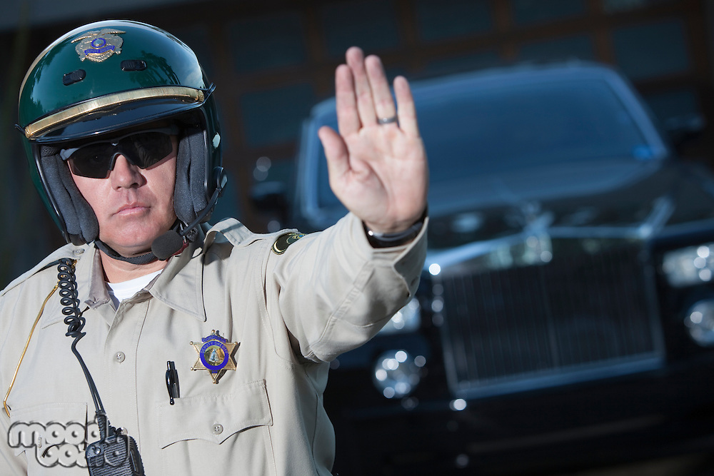 Patrol officer stops traffic  police escort