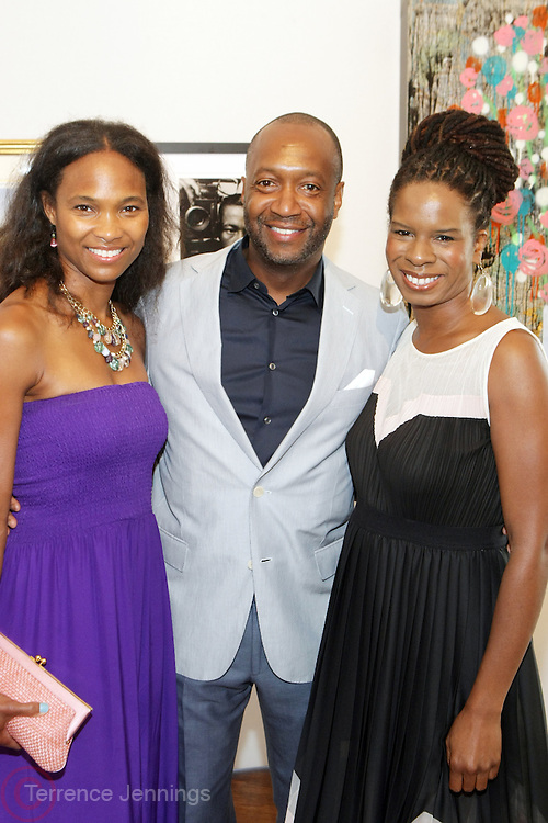 Water Mill, New York: (L-R) Nicole Friday, Jeff Friday, Founder & CEO, Film Life and Tangie Murray, Executive Director, RUSH Philanthropic Arts Foundation attends the RUSH Philanthropic Arts Foundation 15th Annual Art For Life Benefit Gala held in the Hamptons at the Farmview Farms on July 26, 2014  in Water Mill, New York. (Terrence Jennings)