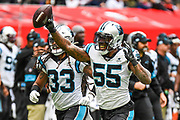 Carolina Panthers Linebacker Bruce Irvin (55) celebrates a turnover with Carolina Panthers Defensive Back Tre Boston (33) during the International Series match between Tampa Bay Buccaneers and Carolina Panthers at Tottenham Hotspur Stadium, London, United Kingdom on 13 October 2019.
