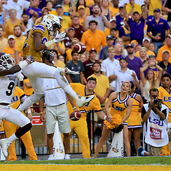 Sep 17, 2016; Baton Rouge, LA, USA;  LSU Tigers wide receiver D.J. Chark (82) drops a pass as Mississippi State Bulldogs defensive back Jamoral Graham (9) defends during the first quarter of a game at Tiger Stadium. Mandatory Credit: Derick E. Hingle-USA TODAY Sports