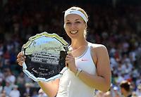 Tennis - 2013 Wimbledon Championships - Womens Final<br /> <br /> Marion Bartoli against Sabine Lisicki<br /> Sabine Lisicki shows off her runners up plate