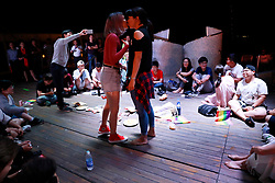 Chinese lesbians kiss as they play games during an interaction session on a cruise organised by the Parents and Friends of Lesbians and Gays (PFLAG) China organisation as they ship leaves Sasebo, Nagasaki, Japan, 16 June 2017. About 800 members of the Chinese LGBT (lesbian, gay, bisexual and transgender) community and their parents spent four days on a cruise trip organised by Parents and Friends of Lesbians and Gays (PFLAG) China, a grassroots non-government organisation, celebrating the 10th anniversary of the organisation. It aims to promote coexistence among homosexuals and their families.