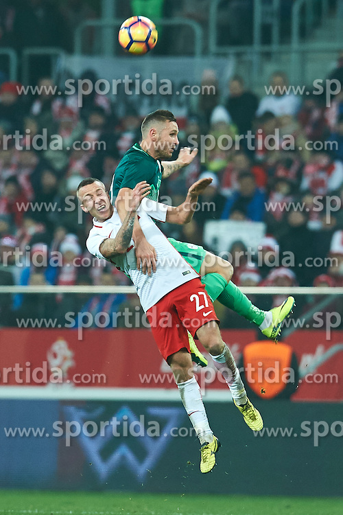 Wroclaw, Poland - 2016 November 14: (L) Jacek Goralski of Poland fights for the ball with (R) Jasmin Kurtic of Slovenia during Poland v Slovenia - International Friendly Soccer Match at Municipal Stadium on November 14, 2016 in Wroclaw, Poland.<br /> <br /> Adam Nurkiewicz declares that he has no rights to the image of people at the photographs of his authorship.<br /> <br /> Picture also available in RAW (NEF) or TIFF format on special request.<br /> <br /> Any editorial, commercial or promotional use requires written permission from the author of image.<br /> <br /> Mandatory credit:<br /> Photo by © Adam Nurkiewicz / Mediasport