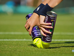 LONDON, ENGLAND - Tuesday, June 30, 2009: A ball girl opens a tin of new balls during the Ladies' Singles Quarterfinal on day eight of the Wimbledon Lawn Tennis Championships at the All England Lawn Tennis and Croquet Club. (Pic by David Rawcliffe/Propaganda)