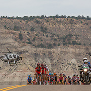 The peloton crests a hill outside of Tropic during the 130-mile stage two en route to Torrey.